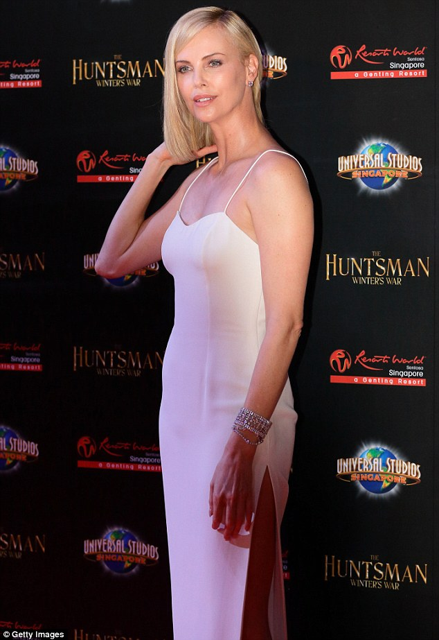 Charlize Theron shows long legs at premiere of The Huntsman: Winter's War in Singapore