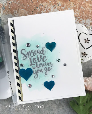With a pretty watercolor wash, sparkly splattering, and beautiful heat embossed sentiment, this card is a lovely way to wish a bon voyage, good luck to a first time college student, or just because you want to send some love.  Created using Fun Stampers Journey Spread Love Stamp and Die Bundle, and other FSJ products.