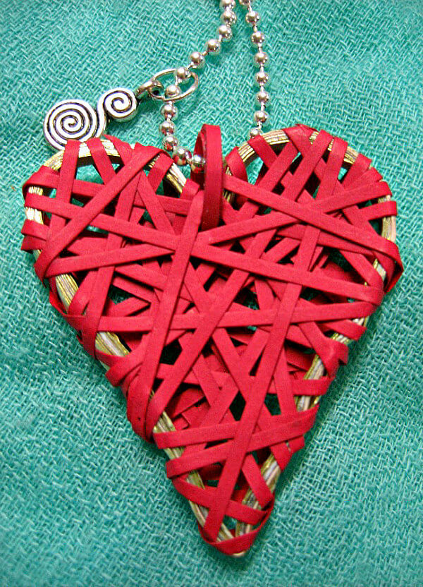 paper heart frame on chain and wrapped with quilling strips to wear as a necklace