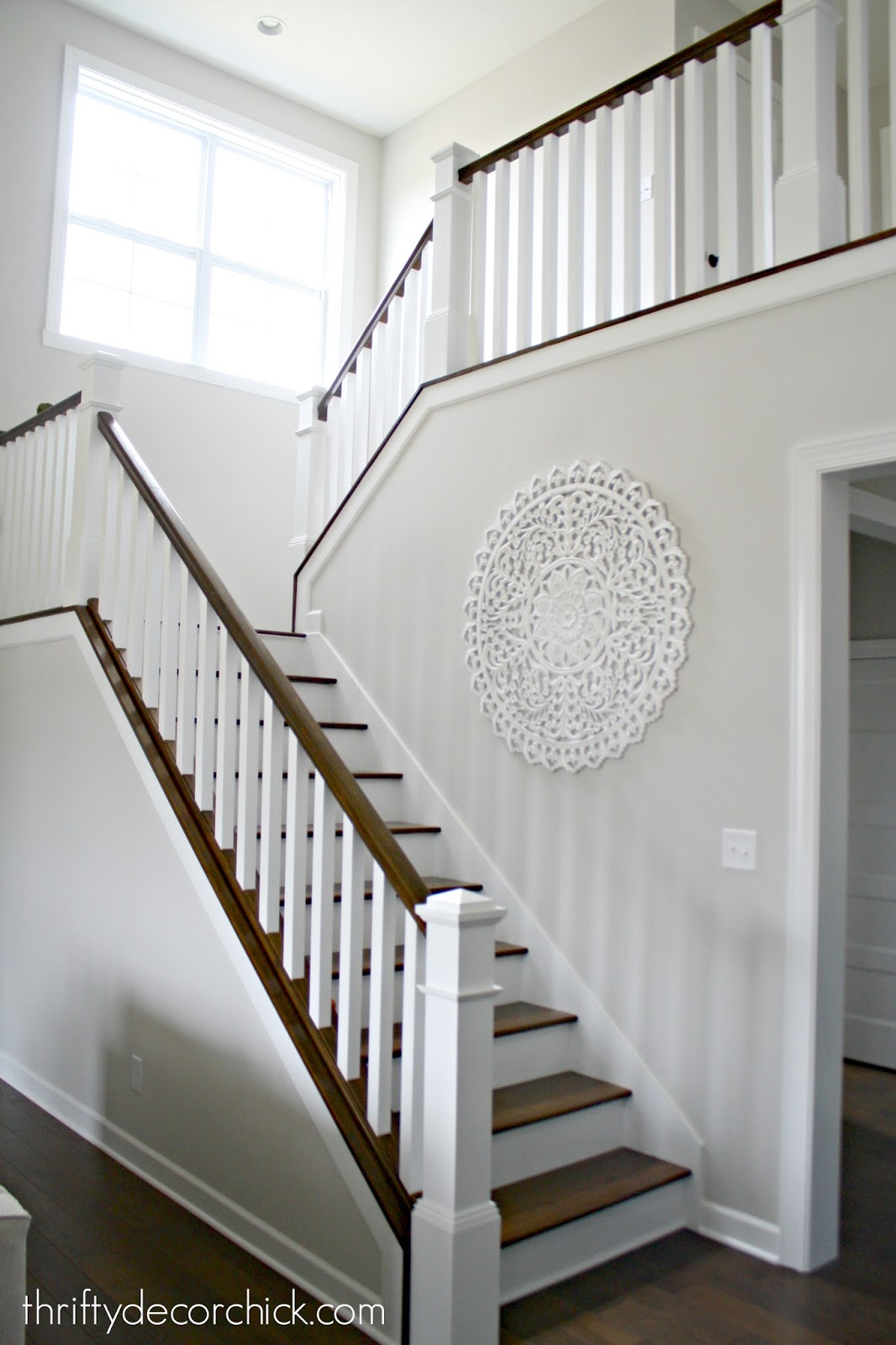 White and stained stairs with balusters