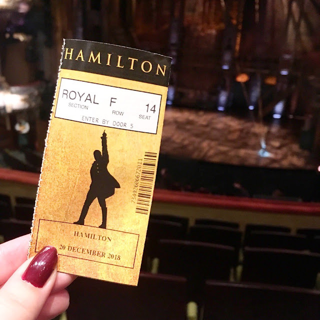Hamilton at the Victoria Palace Theatre - ticket with stage in background