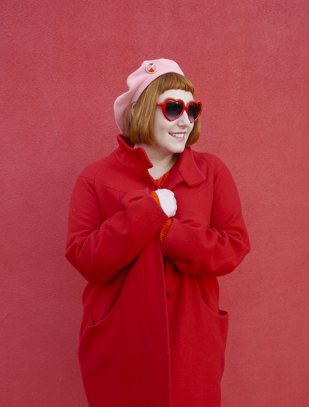 Scottish blogger Helen of Wardrobe Conversations keeps warm in a red coat