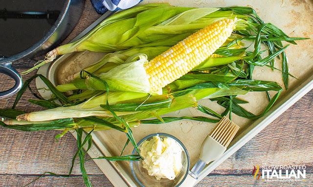 Husks pulled back on corn