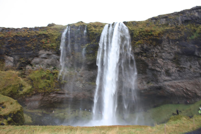 Seljalandsfoss  Waterfall in Southern Iceland gives a unique vantage point allowing visitors to walk behind.