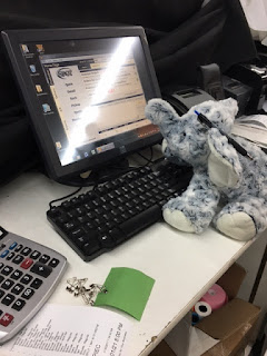 The Elephant working at a desk in front of a computer