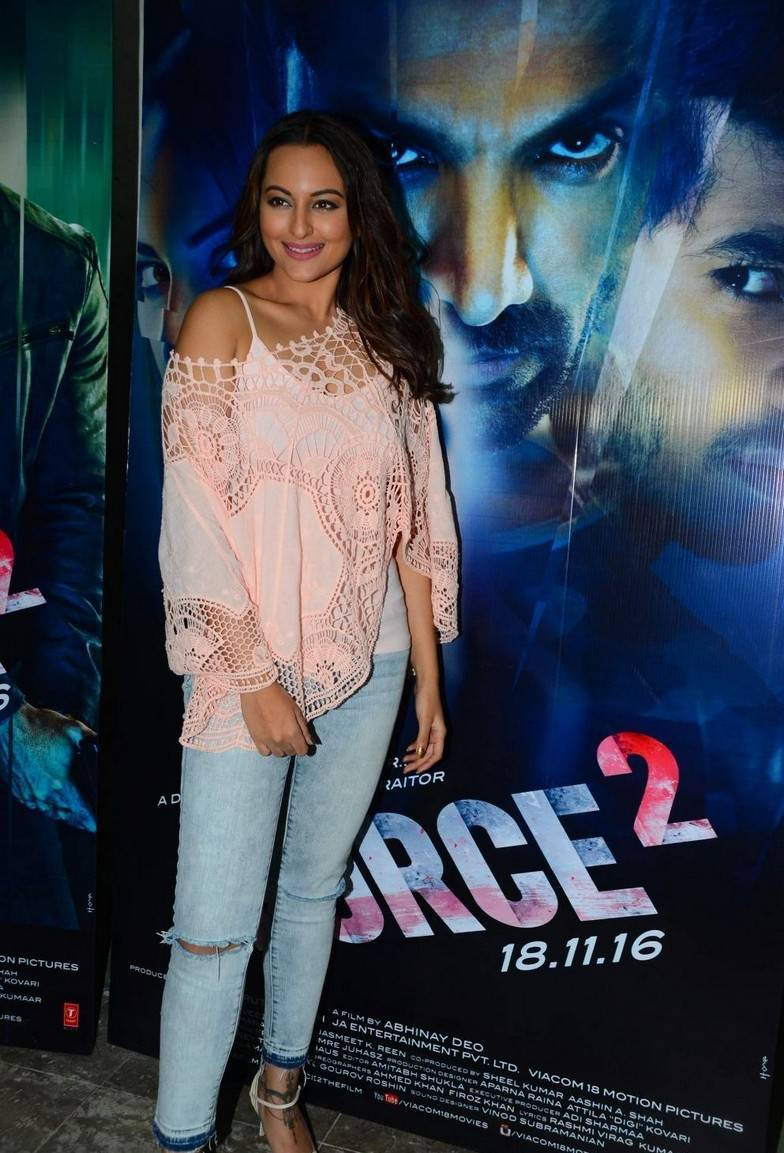 Hindi Actress Sonakshi Sinha In Pink Top Blue Jeans
