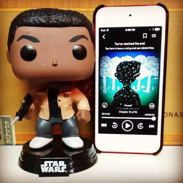A large-headed Funko Pop of Finn from Star Wars stands next to a white iPod with The Dreamer's cover on its screen. The cover features the star-filled silhouette of a boy against a forested background.