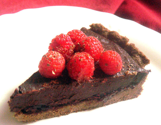 Dark Chocolate Truffle Tart with Mixed Berries in a Teff Crust