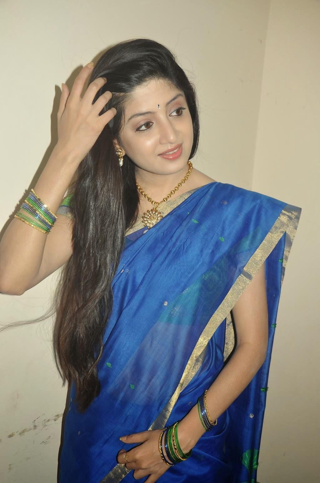 Poonam Kaur Photos in Blue Saree at Acharam Movie On ...