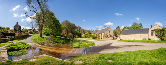 Cotswold village of Upper Slaughter in this bright spring panoramic photograph