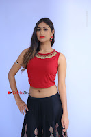 Telugu Actress Nishi Ganda Stills in Red Blouse and Black Skirt at Tik Tak Telugu Movie Audio Launch .COM 0036.JPG