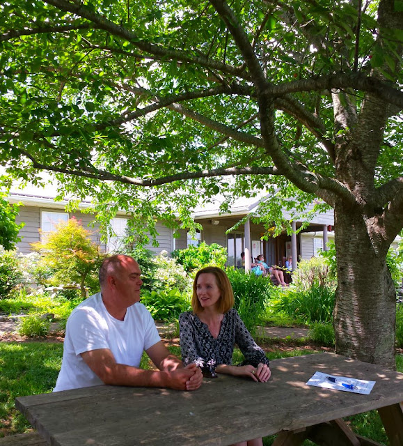NC Wine Adventures in the Yadkin Valley Wine Region. Great for a getaway for girlfriends, families, and couples. In this post, we explore the wines of six different wineries.  Pictured are owners of McRitchie Winery and Ciderworks, Sean and Patricia McRitchie.