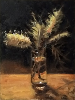 Oil painting of pale yellow Banksia flowers in a glass of water.