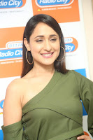 Pragya Jaiswal in a single Sleeves Off Shoulder Green Top Black Leggings promoting JJN Movie at Radio City 10.08.2017 147.JPG