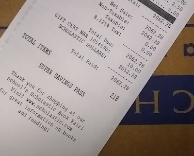 Close-up of receipt, displaying $2,062.28 in purchases, paid for with $2,062.28 in 'Scholastic Dollars'