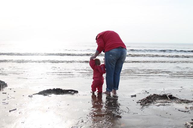 mummy and baby paddling at Brean Beach
