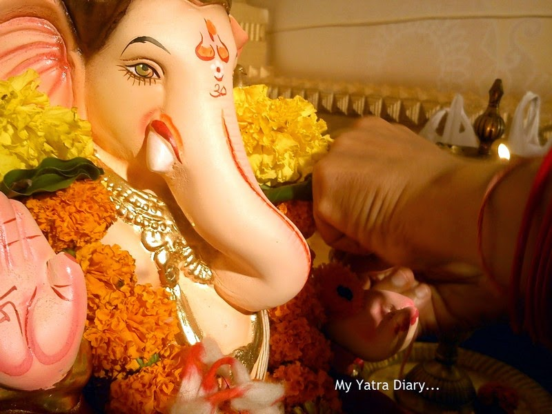 Cute Ganesha with a durva at Mumbai Ganpati Pandal Hopping, during Ganesh Chaturthi festival