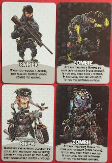 A photo of two of the cards from the I Hate Zombies game, with the front (human) side on the left and the back (zombie) side on the right. Each card has an illustration of the character (in this case, a sniper and a biker) with text describing that character's power. The back shows a zombified version of the character. All zombies have the same power.