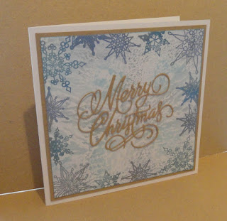 Merry Christmas Card with blue grey shimmery background and kraft sentiment and mat