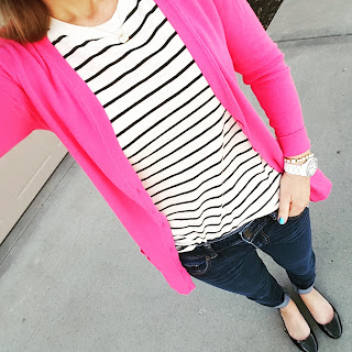 striped top, bright pink cardigan, skinny jeans, black flats