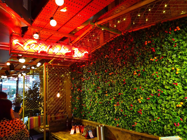 Interior Photo of Caipirinha Bar Neon Sign and Greenery Wall Cabana Manchester