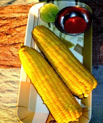 corn on the cob in a serving plate