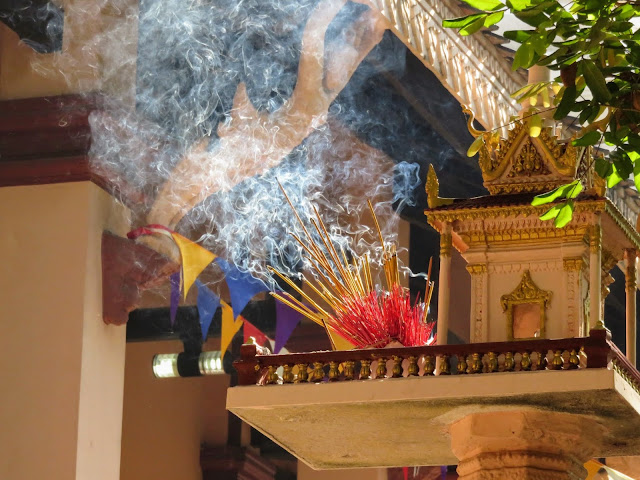 Incense burning at Buddhist temple Wat Phnom in Phnom Penh Cambodia