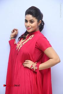 Actress Poorna Latest Stills in Red Dress at Rakshasi First Look Launch  0148.JPG