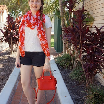 awayfromtheblue instagram christmas shorts and tee outfit star print tee black denim shorts Santa scarf and red bag