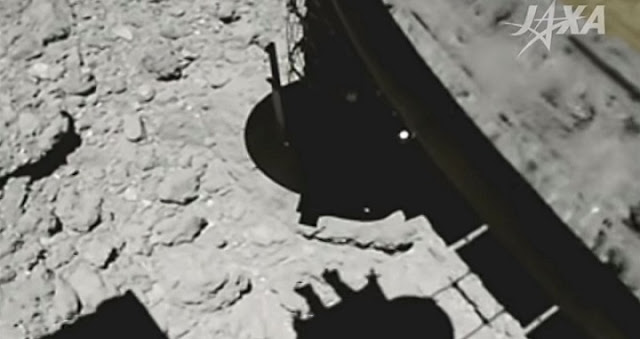 Hayabusa2 descending to the surface of Ryugu, at 4.1 meters above the surface. The black cylinder (top middle) is the sample-collection device. Credit: JAXA