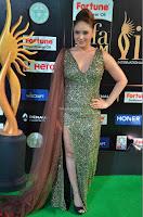 Nikesha Patel in Glittering Leg Split Deep Neck Green Gown at IIFA Utsavam Awards 2017     06.JPG