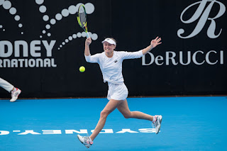 Aliaksandra Sasnovich in White Dress at 2019 Sydney International Tennis