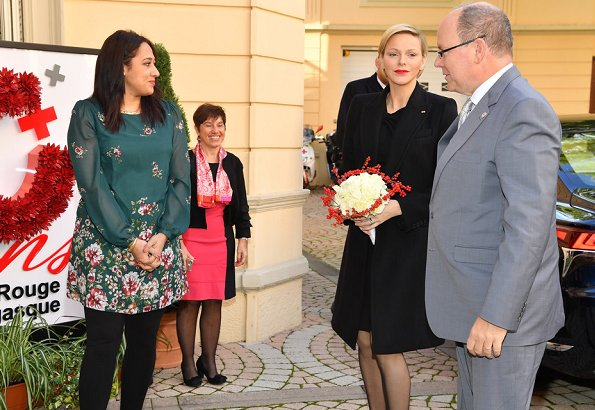 Prince Albert and Princess Charlene distributed gifts to beneficiaries of the Monaco Red Cross on the occasion of the national holiday