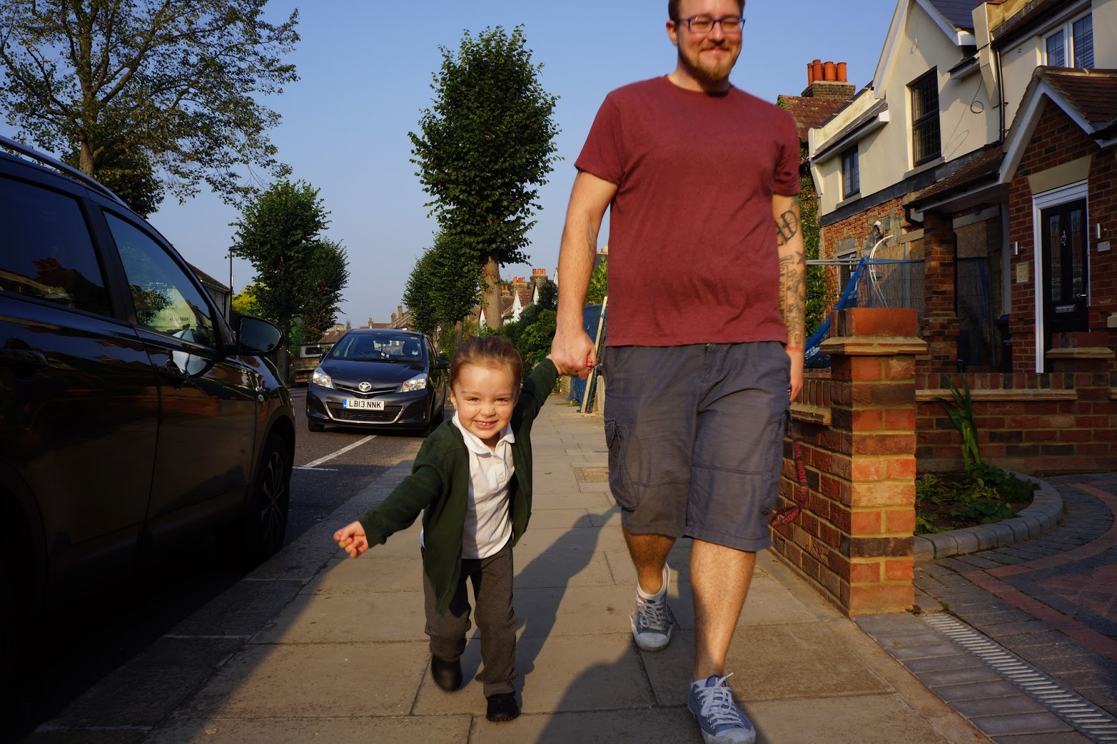 walking with daddy to school nursery