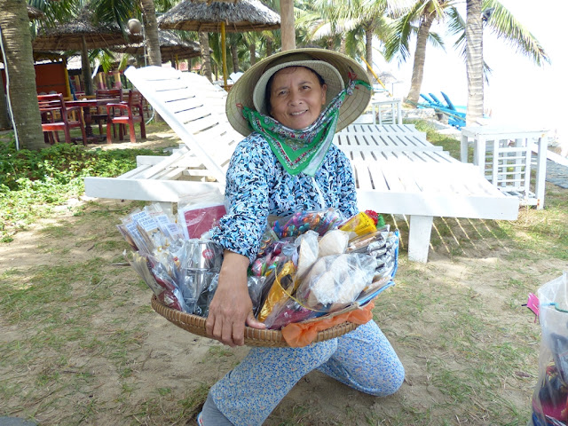 Vietnamese woman selling souvenirs at Cua Dai beach Hoi An