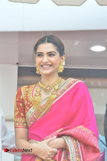Sonam Kapoor in Lovely Red Silk Saree and Gold Jewellery at Kalyan Jewelerss Anna Nagar Showroom Launch