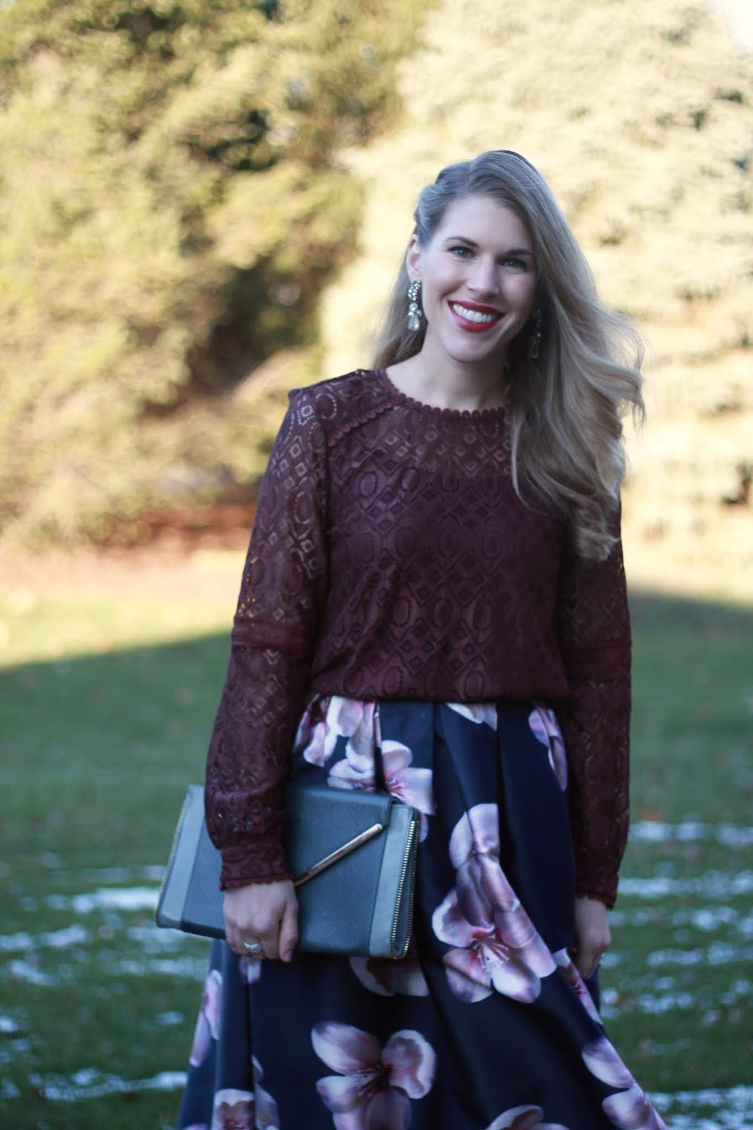 burgundy lace top, navy floral skirt, burgundy pumps, grey envelope clutch