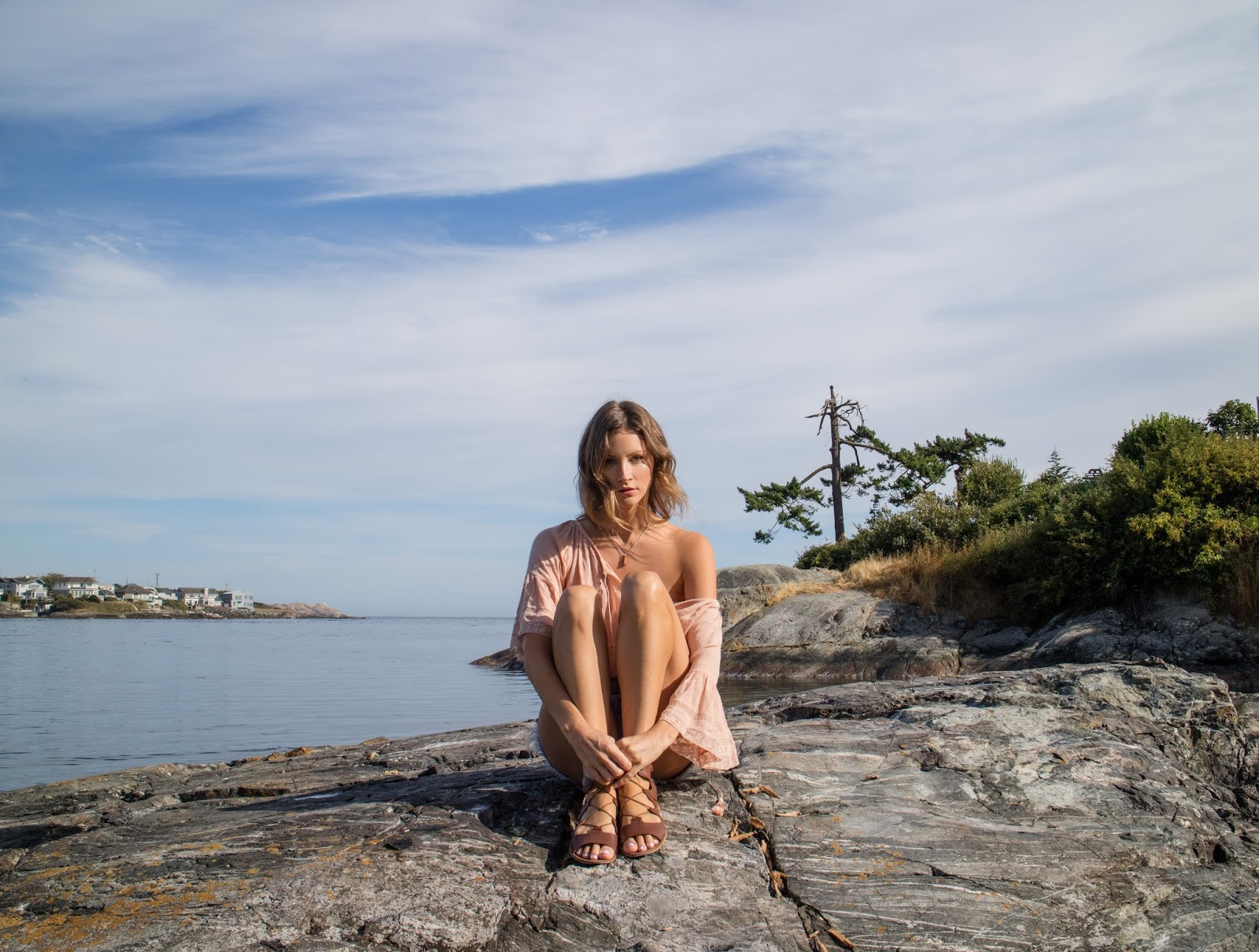fashion blogger, Alison Hutchinson, is wearing a Zara boho off the shoulder blouse, ksubi denim cutoffs, and gladiator sandals at the beach in Victoria