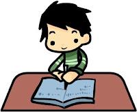 Boy at a desk writing