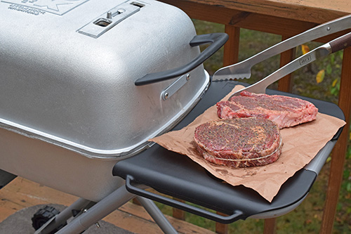 Grilling ribeye steaks on a PK Grill