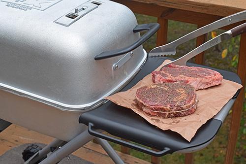 Grilling ribeye steaks on a PK Grill