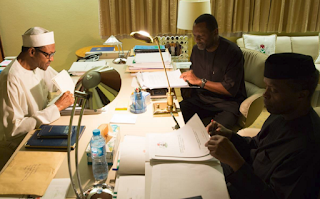 President Buhari, Vice President Osinbajo and Nat. Planning Minister, Udo Udoma scrutinizing 2016 Budget