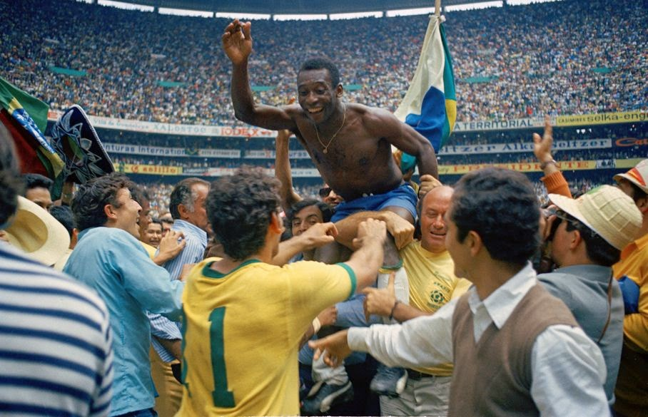 In this June 21, 1970 file photo, Brazil's Pele, centre is hoisted on the shoulders of his teammates after Brazil won the World Cup soccer final against Italy, 4-1, in Mexico City's Estadio Azteca, Mexico. On this day: Perhaps the most glorious day in Brazil's World Cup history. Its third World Cup triumph against a strong Italian side meant it kept the Jules Rimet trophy for good.