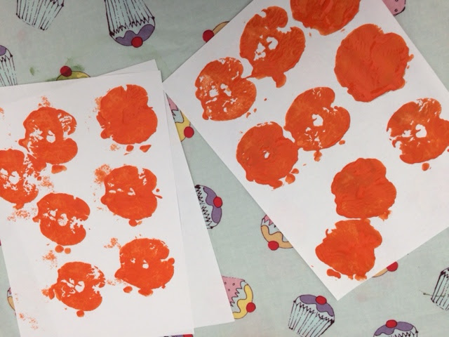 White paper covered in orange apple stamps