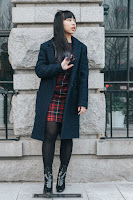 This is a photo about how to style your plaid dress with navy coat and some earrings by Sidney Scarlett from www.sidneyscarlett.com