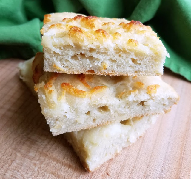 squares of cheesy foccacia stacked on top of each other