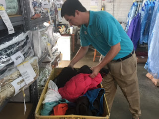 A Cleaner World staff member cleans donations so they are ready for new owners