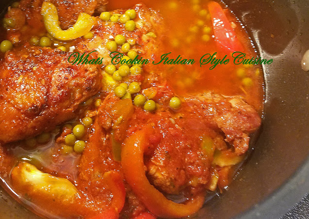 This is a saucepot with chicken thighs and peas similar to a stew made on top of the stove with fresh tomato sauce