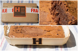 A wooden tray with an H on for Hobbs House Bakery containing a chocolate brownie