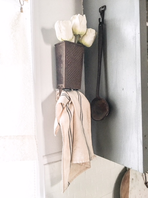 cheese grater towel holder as farmhouse kitchen decor